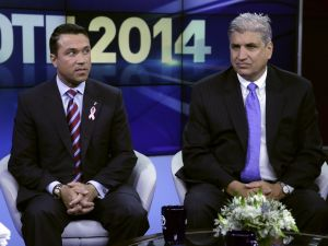 Congressman Michael Grimm and challenger Domenic Recchia at a WABC debate. (Photo by Richard Drew-Pool/Getty Images)