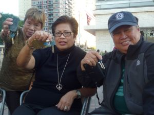 St. Joseph's tenants, from left: Nelida Valmona, Terry De La Paz, and Rose Jean Bulong. (Photo by Heather Dubin)