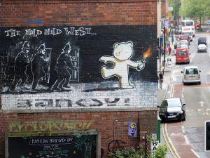 A Banksy in Stokes Croft, Bristol, England.