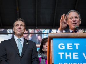 Attorney General Eric Schneiderman at a rally with Gov. Andrew Cuomo. (Photo: Nicholas Perrone)
