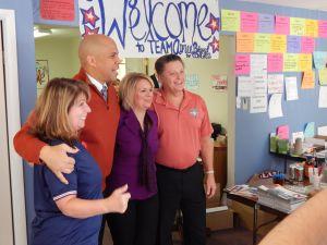 Booker and Belgard pose with volunteers in Burlington County earlier today.