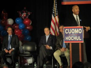 Bronx Borough President Ruben Diaz Jr. speaks as Puerto Rican Gov. Alejandro Garcia-Padilla, Gov. Andrew Cuomo and Attorney General Eric Schneiderman look on (Photo: Will Bredderman).