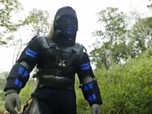 Mr. Rosolie's snake-proof suit. (YouTube)