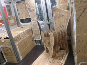 Someone decided to decorate the subway with cardboard furniture (arenizi/Reddit)