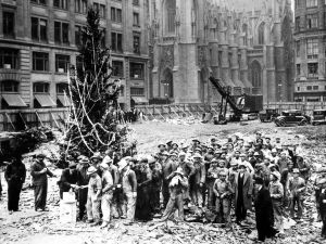 The first tree is erected by the Rockefeller's construction workers in 1931.