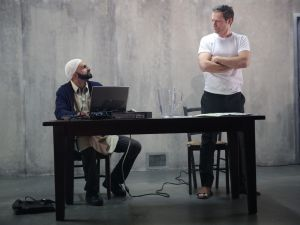 Usman Ally and Justin Kirk in The Invisible Hand.