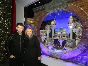 Nick Jonas and Liz Rodbell celebrating the Lord & Taylor windows. (Photo via Getty)