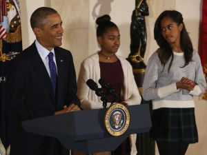 President Obama pardons a turkey as his daughters watch. (Photo by Mark Wilson/Getty Images)
