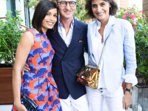 Freida Pinto, Bruno Frisoni, and Ines de la Fressange hug at Roger Vivier's Miami party. (Photo courtesy of BFA)