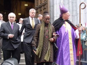 Police Commissioner Bill Bratton, Mayor Bill de Blasio, first lady Chirlane McCray and Cardinal Timothy Dolan leave St. Patrick's Cathedral this morning. (Photo: Jillian Jorgensen)