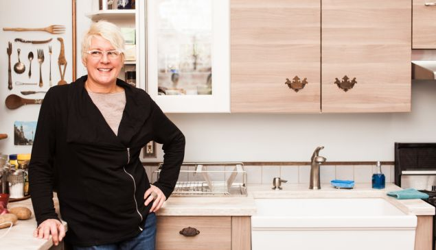 Manhattan BnB owner Anne Edris in her Avenue C BnB that had recently been forced into closure. (Photo by Emily Assiran/New York Observer)