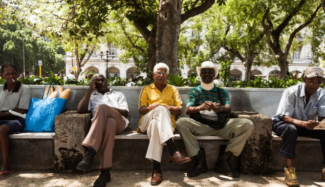 Men sitting in Old Havana. (Photo by Emily Assiran/New York Observer)