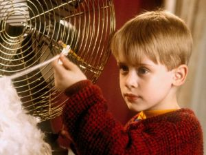 Museum security expert Kevin McCallister installing homemade booby traps in the 1990 Christmas classic Home Alone. (Photo via parentdish.co.uk)