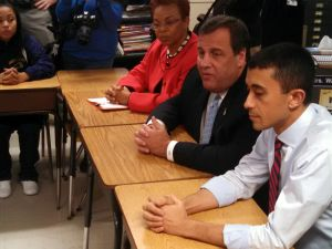 Christie sits with Mayor Dana Redd, Camden Public Schools Superintendent Paymon Rouhanifard, and students of Camden High School prior to announcing $50 million in SDA funds to go towards building rehabilitation.