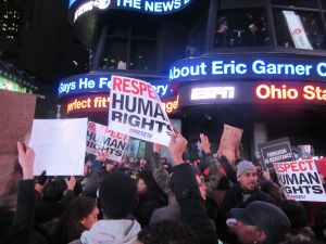 1199 SEIU members and other activists gather in Times Square (Photo: Will Bredderman).