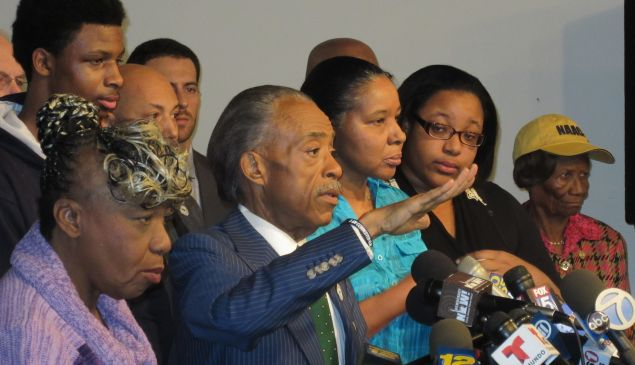 Rev. Al Sharpton surrounded by the family of Eric Garner.