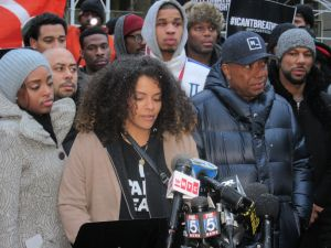Russell Simmons stands outside City Hall next to rapper Common and leaders from Gathering for Justice (Photo: Will Bredderman).