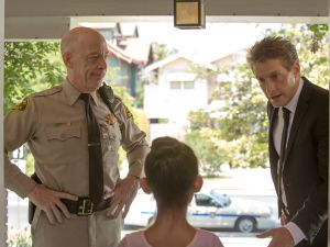 J.K. Simmons, left, and Fran Kranz on the hunt for an unfortunate feline.
