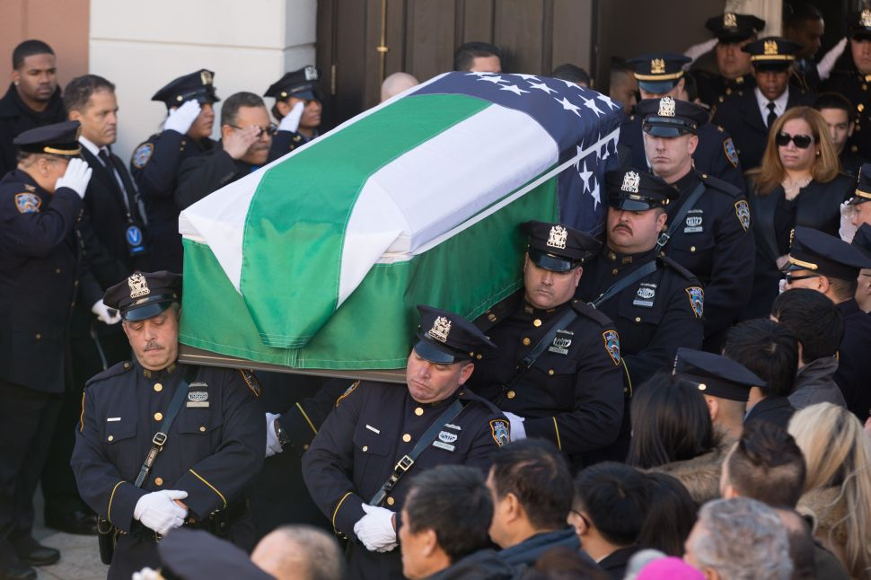 Dignitaries, and Thousands of Cops, Mourn NYPD Officer Rafael Ramos at Funeral