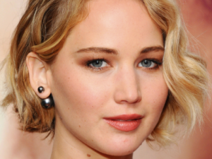 Jennifer Lawrence's textured bob was indisputably the hairstyle of the year. We can barely remember when she looked like the photo at left. (Photos via Getty)