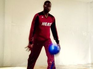 Dwayne Wade paints with basketballs. (Photo via Art of Miami, courtesy Dwayne Wade's Facebook)
