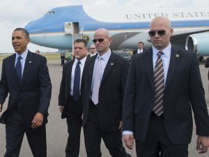 US President Barack Obama (L), surrounded by US Secret Service agents, walks to greet guests upon arrival on Air Force One at Tampa International Airport in Tampa, Florida, on April 13, 2012. (SAUL LOEB/AFP/Getty Images)