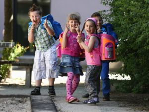 (L-R) The kids Dario, Natalie, Eleni and Ferhart from kindergarten 'Schneckenhaus' walk along a path with their new satchels on June 5, 2013 in Berlin, Germany. (Photo by Andreas Rentz/Getty Images)
