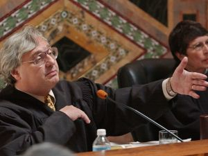 Judge Alex Kozinski (L), of the 9th U.S. Circuit Court of Appeals, pictured here in 2003 in San Francisco, has indicated that the judiciary is finally ready to stop prosecutors from lying and soliciting others to lie. (Paul Sakuma-Pool/Getty Images)