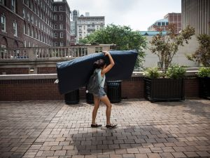 Emma Sulkowicz, a senior visual arts student at Columbia University, carries a mattress in protest (Photo by Andrew Burton/Getty Images)