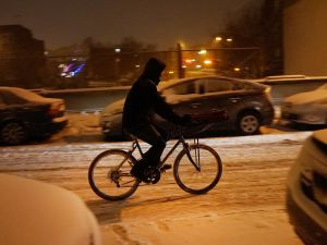 These guys deserve higher-than-normal tips for biking during inclement weather. (Photo: Getty Images)