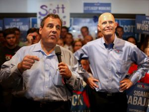Christie stands with Florida Governor Rick Scott as they make a campaign stop at a Vero Beach Field Office earlier this year. (Photo by Joe Raedle/Getty Images)