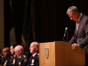 Mayor Bill de Blasio speaks at an NYPD swearing-in ceremony. (Photo by Spencer Platt/Getty Images))