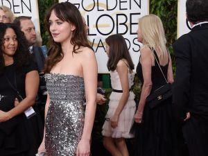 Most Inventive Take on the Juicy Couture Smocked Bathing Suit Coverup: Dakota Johnson
