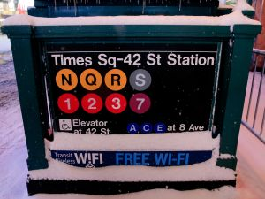 Snowfall on the Times Square subway station last night. (Photo: Alex Trautwig/Getty Images)