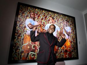Artist Kehinde Wiley stands in front of one of his paintings (Photo: Andreas Rentz/Getty Images for PUMA).