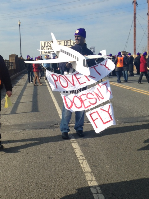 On Martin Luther King Jr.'s birthday, Newark airport workers hold sit-down protest