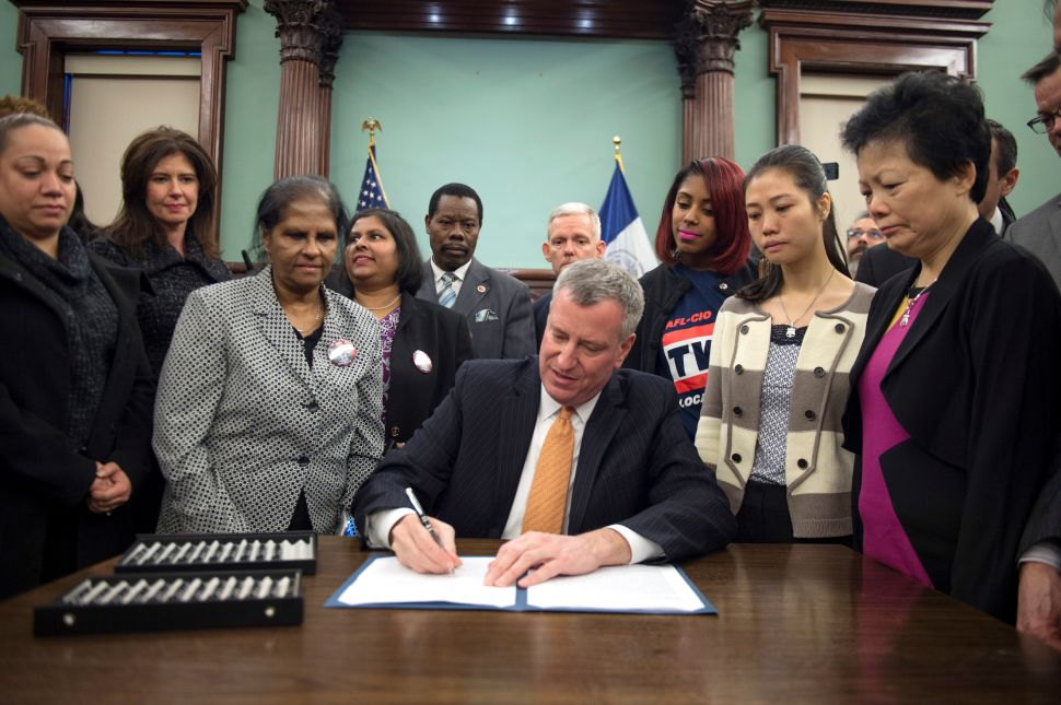 Bill de Blasio Signs Law to Name Streets for Slain NYPD Officers