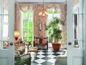 A sunroom with generous windows overlooks the garden. (Scott Wintrow/Gamut Photos)