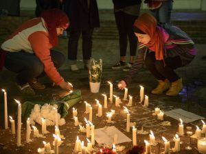People stand by as a makeshift memorial is made after vigil at the University of North Carolina following the murders of three Muslim students on February 11, 2015 in Chapel Hill, North Carolina. (Photo: Brendan Smialowski/ Getty Images)