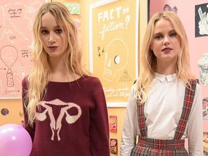 The model in the middle wears a sweater with female reproductive organs (Photo: Getty).