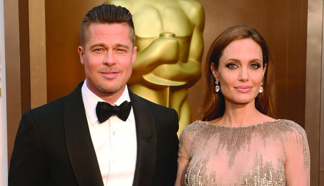 Brad Pitt with his wife, Angelina Jolie, at the 86th Academy Awards show
