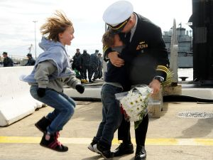 Children welcome home their father