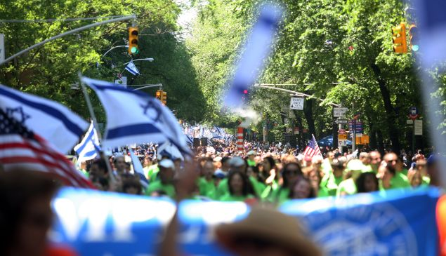 Participants in the annual Salute to Israel Parade march showing their support and pride for Israel May 31, 2009 in New York City. Thousands marched up Fifth Avenue to celebrate the creation of the State of Israel in 1948 and also the 100th birthday of the city of Tel Aviv. (Photo by Hiroko Masuike/Getty Images)