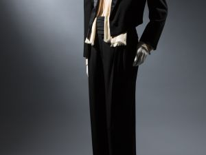 Saint Laurent Rive Gauche, smoking evening suit made of black wool and satin. Photo: courtesy of the Museum at FIT