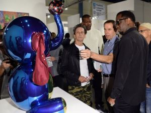 Brian Grazer, Jeff Koons, and Sean Combs may find themselves mingling together more often at UTA Fine Arts. (Photo courtesy Getty Images)