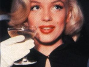 Marilyn Monroe and her glass of champagne.