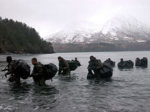 Navy SEALs perform Advanced Cold Weather training to experience the physical stress of the environment and how their equipment will operate, or even sound, in adverse conditions December 14, 2003 in Kodiak, Alaska. Navy SEALs are maritime special operations forces that strike from the sea, air and land. They operate in small numbers, infiltrating their objective areas by fixed-wing aircraft, helicopters, Navy surface ships, combatant craft and submarines. SEALs have the ability to conduct a variety of high-risk missions, utilizing unconventional warfare, direct action, special reconnaissance, combat search and rescue, diversionary attacks and precision strikes. (Photo by Photographer's Mate 2nd Class Eric S. Logsdon/U.S. Navy via Getty Images)