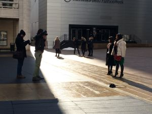 Photographers snap away in shadow of the famed Lincoln Center tents