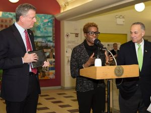 NYCHA Chairwoman and CEO Shola Olatoye flanked by Mayor Bill de Blasio and Senator Charles Schumer (Photo: Facebook).