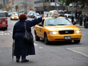 A woman tries to hail a taxi on First Avenue October 31, 2012 in New York. (Getty)